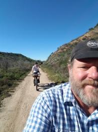 nolan-riding-behind-dad